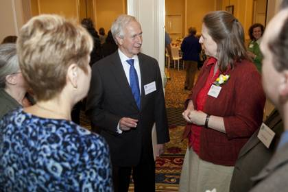 President Richard H. Brodhead talks with Meg Brown, right. Brown received a Meritorious Award in the clinical/professional area. Photo by Megan Morr.