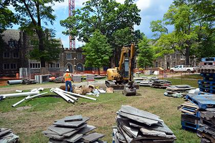 Construction is taking place this summer to remove bluestone sidewalks along the West Campus Quad in order to improve drainage and irrigation before replacing the same stone. Work will occur through August as the first phase of a three-year project. Phot