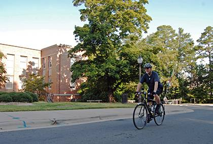 Randy Best, administrative manager for Duke's Physics Department, rides his bike to work each day. He'll be among hundreds of other bike riders motorists should watch out for on Duke's campus. Photo by Bryan Roth.
