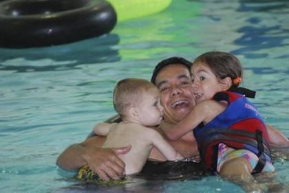 Vann Rolfson and his family attended a Family Fun Swim event at Brodie Recreation Center last year. Duke community members receive discounts on pool programs and outdoor adventure trips and clinics. Photo courtesy of Duke Recreation.