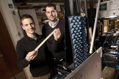"The Office of Research Support helps to secure funding for projects at Duke like this one by graduate Student John Hunt, left, and post-doc Tom Driscoll at right. The pair fabricated a unique material, known as a metamaterial, that acts as a ""lens"" t"