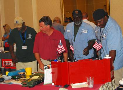 Members of Duke's Facilities Management Department check out products during the 2010 Safety Fair.