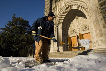 Landscape specialist Elvis Holden removes snow in front of Duke Chapel during a 2010 snowfall. Along with other Facilities staff, Holden will clear priority roads, parking lots and more in case of a winter snowfall. Courtesty of Duke Photo.