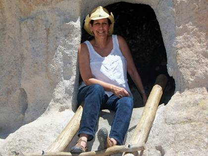 Along with reading, Lillian Spiller also enjoys travel. Here, she stops for a picture while climbing Bandelier National Monument in New Mexico. Photo courtesy of Lillian Spiller.