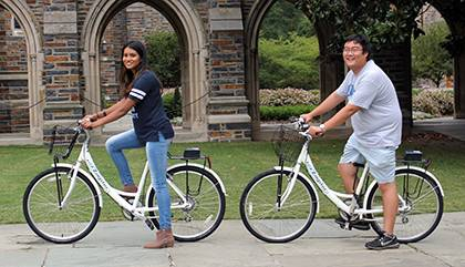 Students Lavanya Sunder and Ray Li pose with new bicycles that will be part of the Zagster bike-share program for students, faculty and staff. With an annual fee, bikes will be available for rent beginning this month. Photo by Chris Heltne.