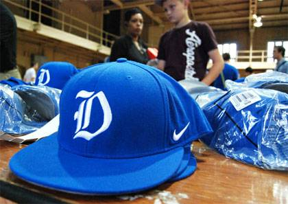 Duke hats lined up for sale at the Duke Athletics Surplus Sale.  Photo by Bryan Roth