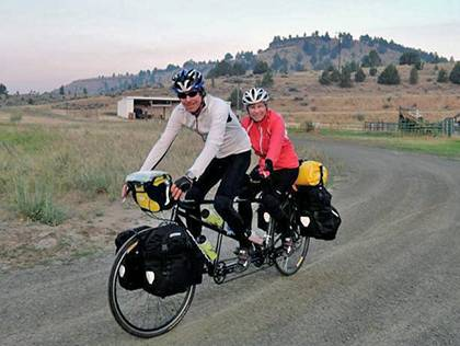 Duke biology professor Kathleen Smith and her husband, Bill Kier, ride out of camp in Paulina, Oregon. They made a pit stop because their route was detoured due to forest fires. Photo courtesy of Kathleen Smith
