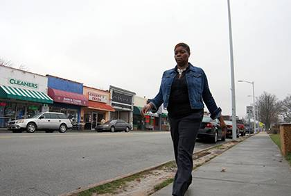 To ease her daily stress, Telissa Robinson often takes a quick walk from her office at Erwin Sqaure over to Ninth Street and back. Photo by Bryan Roth.