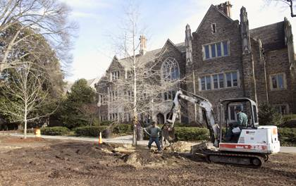 A Facilities Management crew plants new trees by the Allen Building in 2011. The planting was part of Duke's ongoing tree-care plan. Photo by Duke Photography.