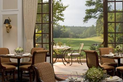 Visitors to the Washington Duke Inn and Golf Club can dine at the Fairview Dining Room and enjoy sceneic views of the historic property. Photo courtesy of the Washington Duke Inn and Golf Club.