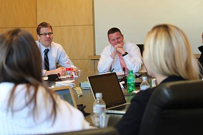Jeff Ward, center-left, lecturing fellow and director of the Start-Up Ventures Clinic at Duke School of Law, works with students to provide legal advice and assistance to seed and early-stage entrepreneurial ventures