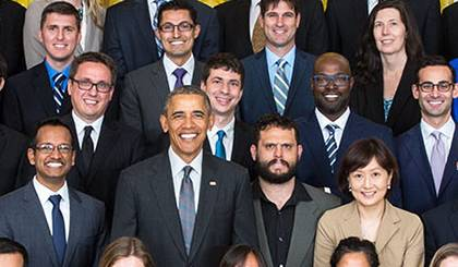 Dr. Kafui Dzirasa, shown second from the right behind President Obama.