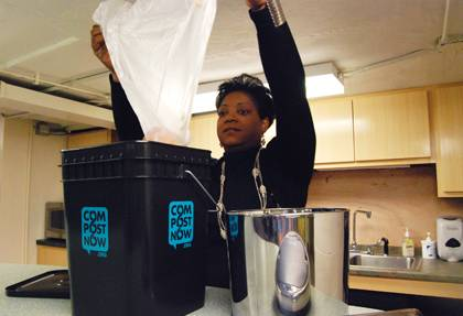 Lisa Moore, accounting specialist with Chapel Services, empties a bag of compostable material into a composting bucket. The bucket is shared among Duke community members who use a shared kitchen at the Chapel. Photo by Bryan Roth.