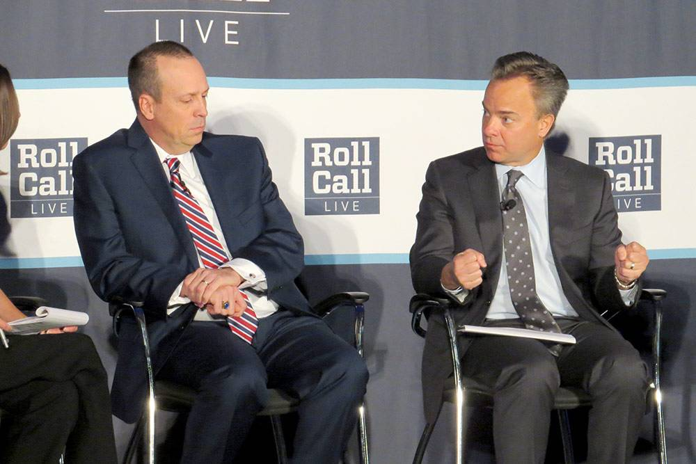 Mark McClellan, right, discusses what's next in health care policy Wednesday at a Roll Call forum. US Senate staff member Rodney Whitlock also participated on the panel. Photo by Jeff Harris