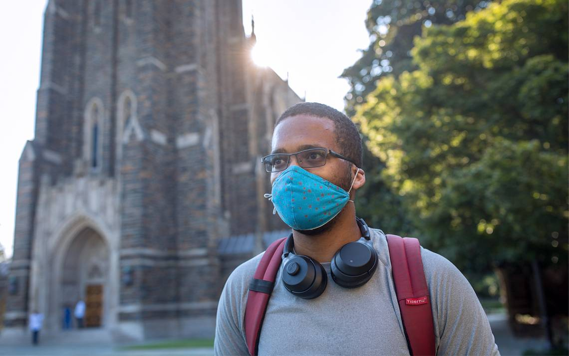 A student wears a mask on Duke's campus.