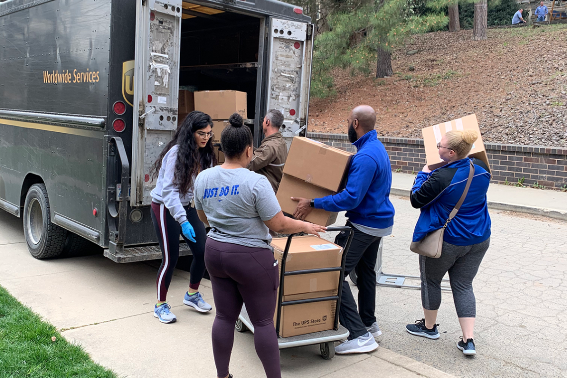 duke staff move packages to be shipped to students during Spring Break week.