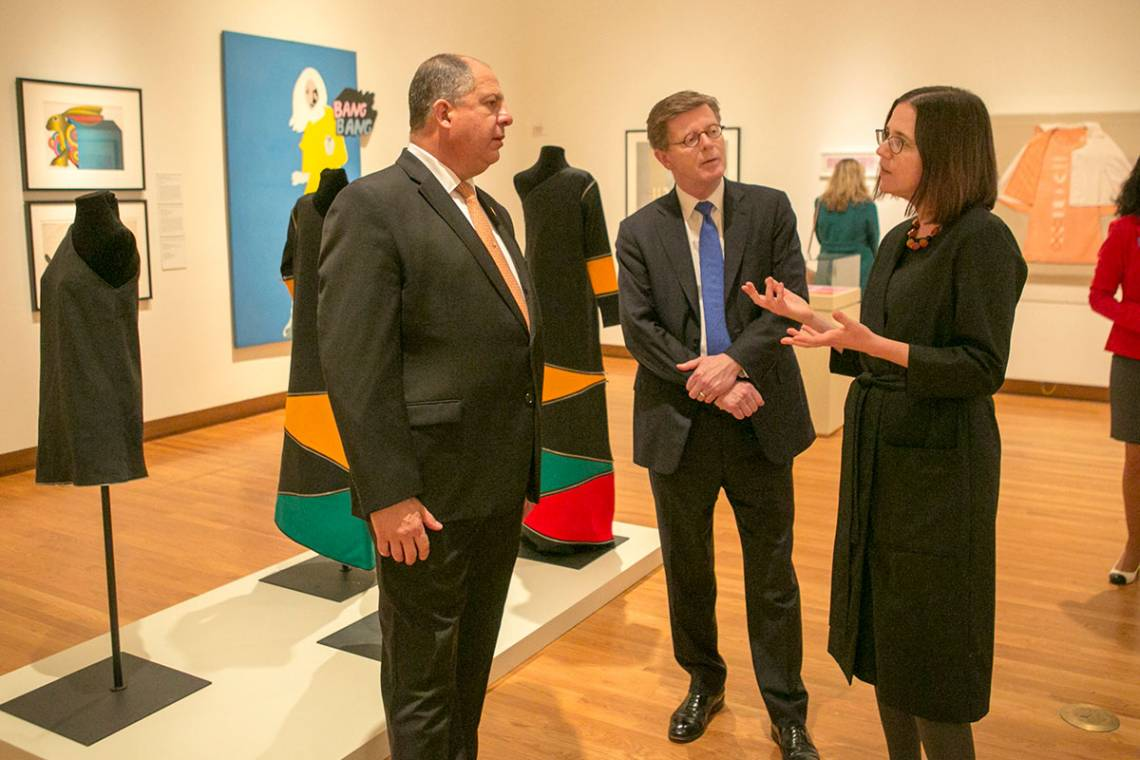 Costa Rican President Solis visits the Pop American exhibit at the Nasher. With him is Duke President Vincent Price and exhibit curator Esther Gabara.