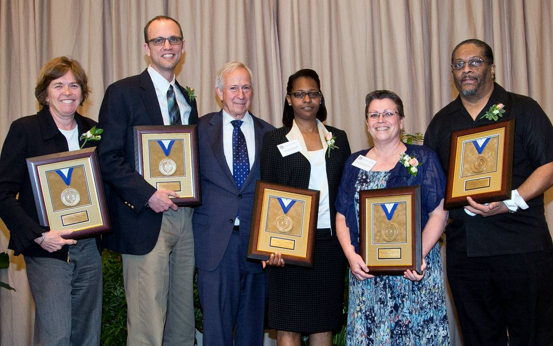 """Posing with President Richard H. Brodhead (center) are 2016 Presidential Award recipients (left to right) Tracy Futhey, Richard Outten, Lakeshia """"Kiwi"""" Whitted, Jean Hartford-Todd and Oliver """"Ollie"""" Miller."""