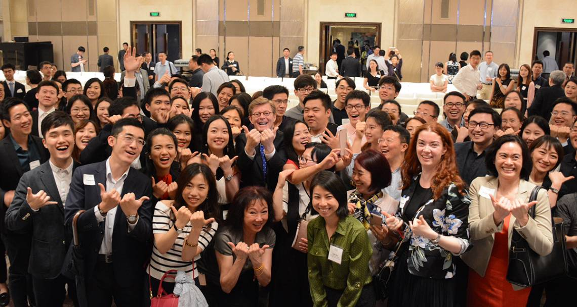 Duke President Vincent Price expresses his Bull City Pride with students and alumni in Shanghai.