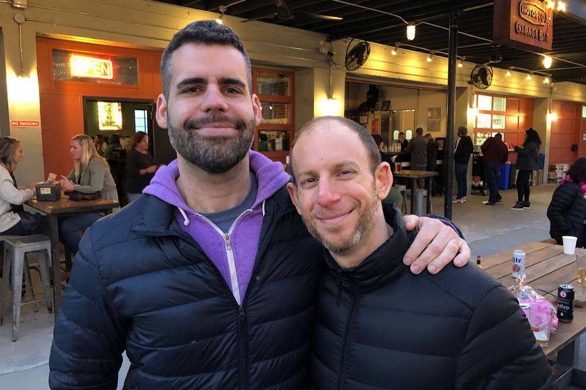 Gabriel Rosenberg (left), a professor of gender, sexuality and feminist studies and history, has been named the new Faculty in Residence (FIR) in Southgate residence hall on East Campus. He is pictured here with his partner  Harris Solomon, an associate p