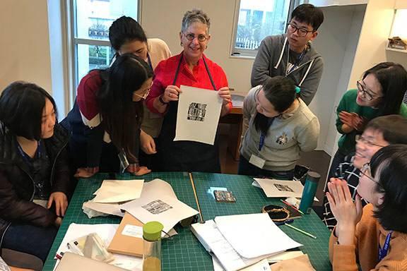 Merrill Shatzman leads a Duke Kunshan class in printmaking and Chinese culture
