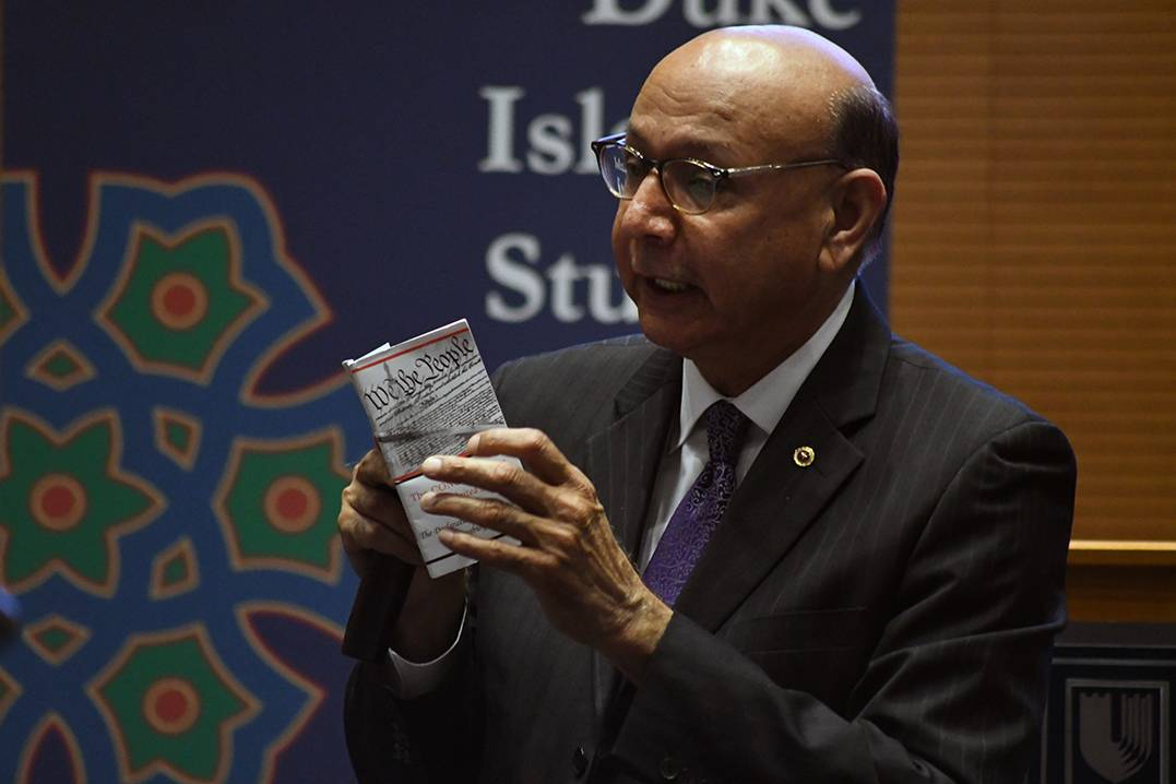 Khizr Khan reads from the constitution during his talk Thursday at Duke. Photo by Bryan Roth/Kenan Institute for Ethics