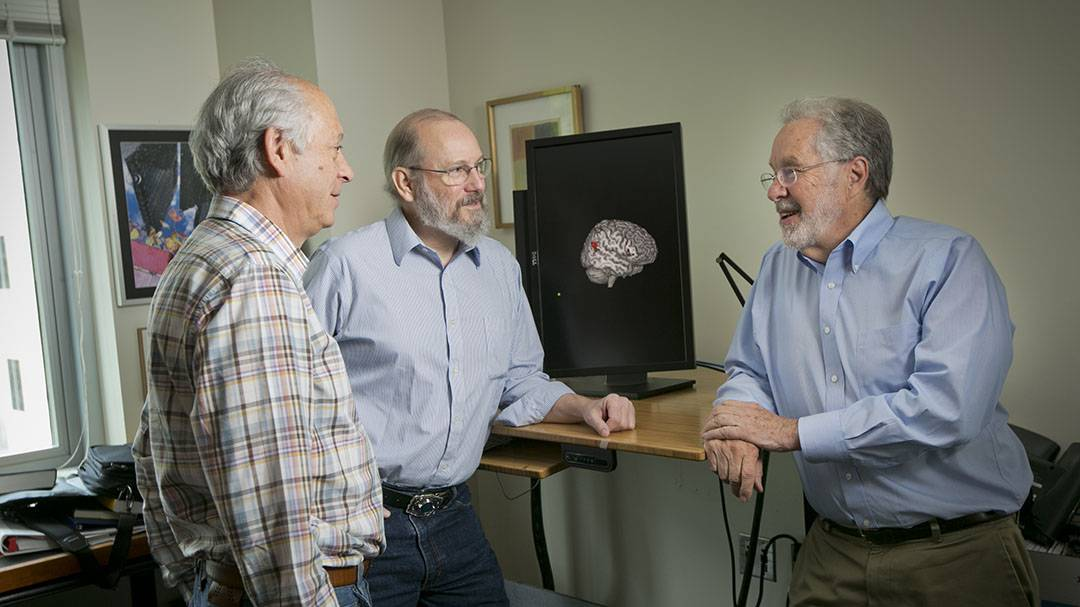 Law professors Donald Beskind (L) and Neil Vidmar (R) joined Pate Skene of Neurobiology in studying jury decisions.