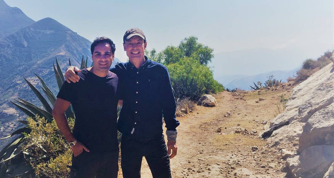 Orin Starn and Miguel La Serna standing in front of mountains in Peru