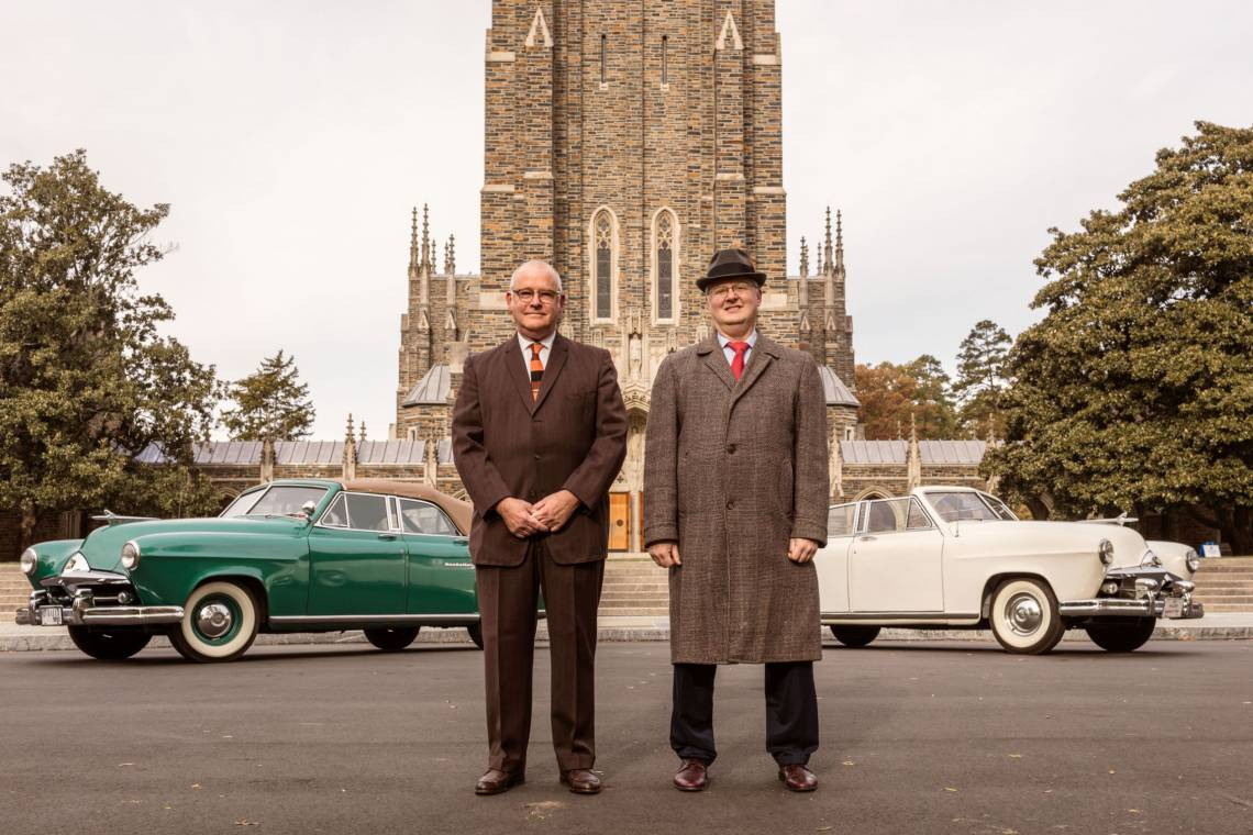 Rex Crews, left, and Nathan Swanson with their 1951 Frazer Manhattan convertibles in front of Duke University Chapel. Both are wearing period-correct 1950s garb. Jeremy M. Lange for the Wall Street Journal