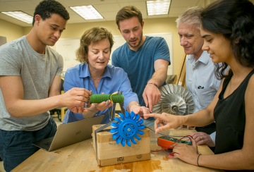 "Emily Klein, professor of earth and ocean sciences, and Josiah Knight, associate professor of mechanical engineering and materials science, work with students from the Bass Connections project team ""Energy andthe Environment: Design and Innovation."""