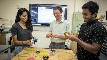 Working on the design of endoscopy dials. From left to right, Lizbeth Leapo (student), Matt Brown (BME lab instructor), Ashish Vankara (student). Photo credits, Chris Hildreth