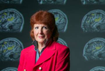 Edna Andrews, photographed in front of images of brain scans. Photo by Megan Mendenhall/Duke Photography