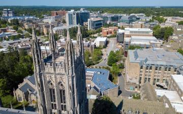 Drone footage captures Duke University Chapel with the Duke University Health System campus in the background. Photo by Bill Snead, Duke University Communications.