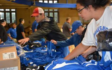 Shoppers look through items at the 2017 Duke Athletics surplus sale.