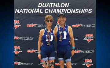 Duke faculty members Rochelle Schwartz-Bloom, left, and Paul Bloom, right, show off their medals at the Duathlon National Championships. Submitted photo.