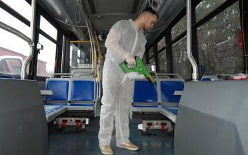 Luke Fenlon of Cenplex Building Services disinfects a Duke bus. Photo by Stephen Schramm.
