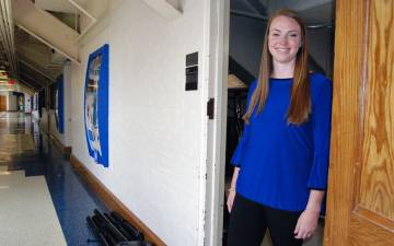 Mikaela Ryan, assistant director of game operations and championships for Duke Athletics, is familiar with the hidden corners of Cameron Indoor Stadium. Photo by Stephen Schramm.
