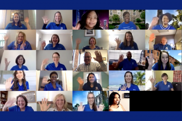 The Career Center put on team shirts for an office Zoom photo.