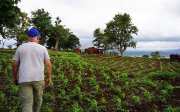 Charles Piot walks through a field in northern Togo. Photo courtesy of Charles Piot.