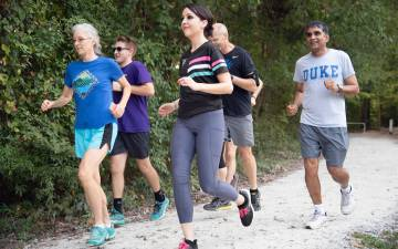 Participants of the Duke Run/Walk Club workout on the Al Buehler Trail. Photo by Les Todd.