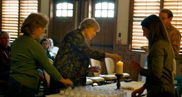 Pastors light candles as part of a ceremony at the start of the Spirited Life Intervention program.