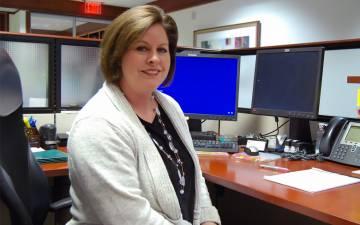 Corrine Starke at her desk.