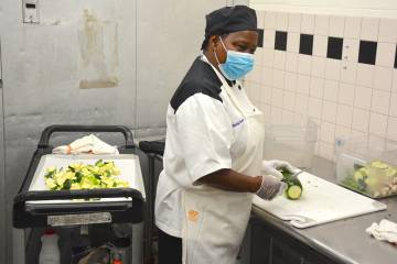 Gloria Daniels, lead production worker for Duke Dining, slices zucchini at Marketplace on East Campus on Friday, Aug. 7, her first day back at work in four months. Photo by Jonathan Black.