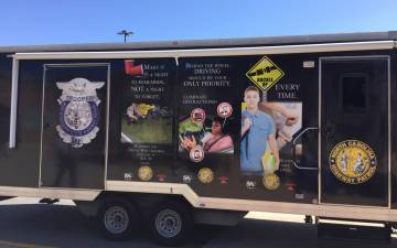 The mobile trailer houses the Distracted Driving Simulator.