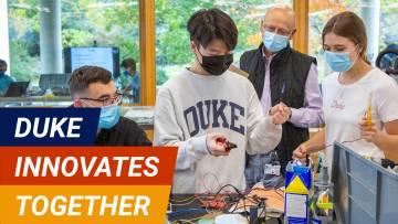 Duke scholars in a lab