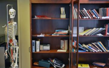 Bookshelves in the Duke Doctor of Physical Therapy Program office are emptying as staff members give away old textbooks and academic journals to students.