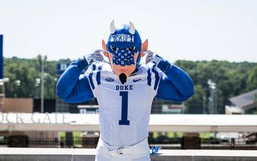 Blue Devil mascot in a protective mask