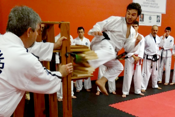 Ricky Hollenbach breaking boards in tawkwon-do