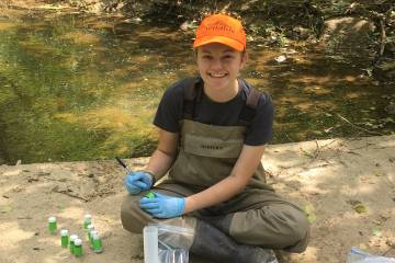 Duke undergraduate Laura Naslund '19 and colleagues have found high levels of selenium in aquatic insects and the spiders that feed on them downstream from a major coal mining site in southern West Virginia. Photo by Jacqueline Gerson, Duke University