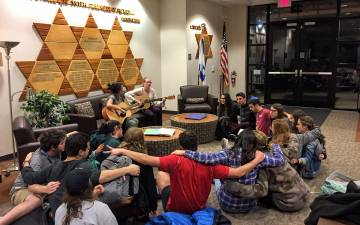 Students and staff partake in Shabbat Shira, a song session, before Shabbat services every Friday. Photo courtesy of the Freeman Center for Jewish Life.